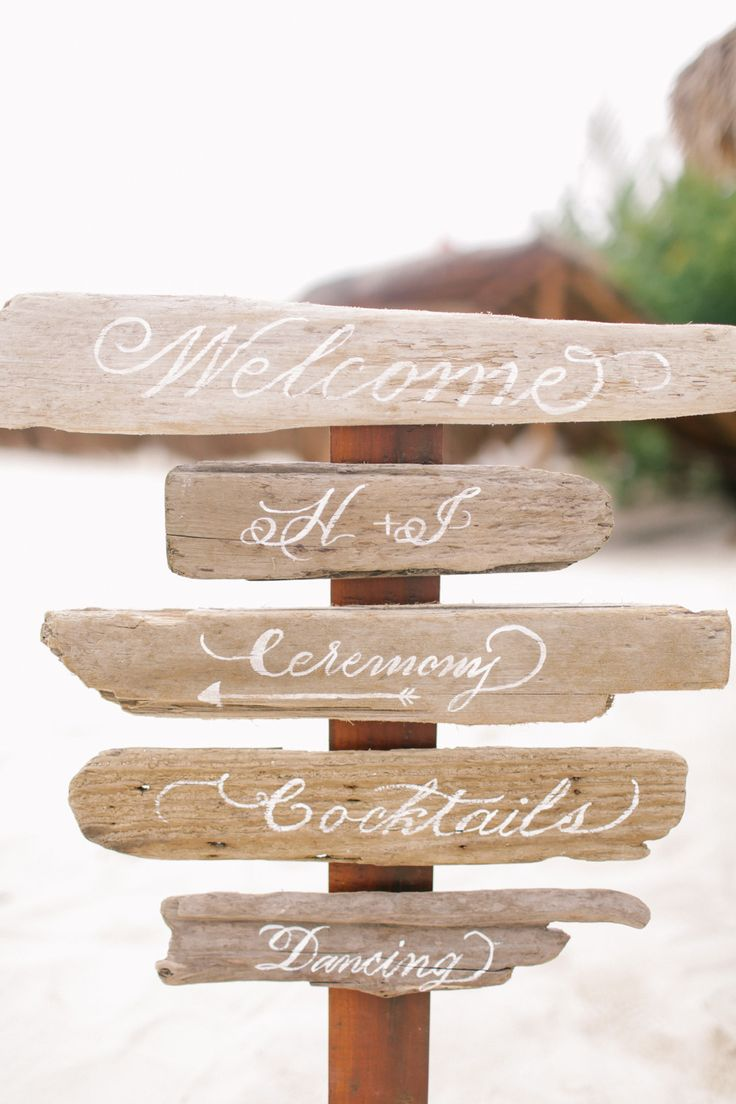 wedding signage made of driftwood is a cool idea for a coastal wedding, it's a very eco friendly idea