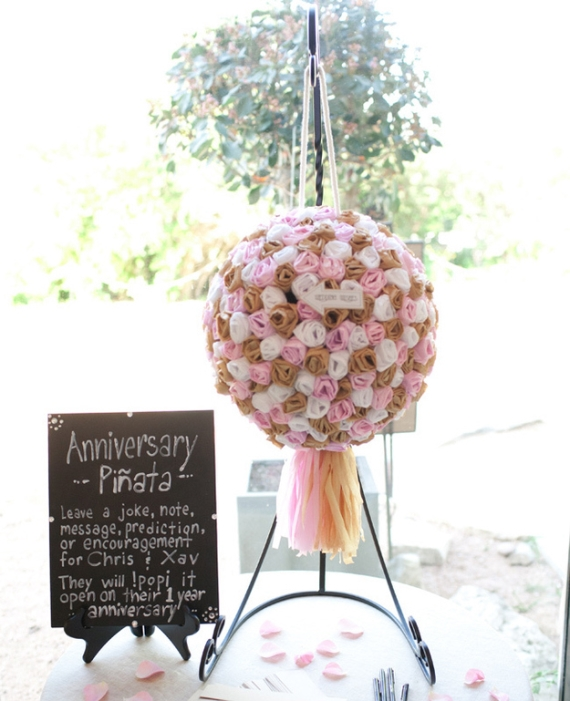 a beautiful rose pinata wedding guest book in white, tan and pink, with a tassel is a lovely idea for any wedding and will bring a touch of fun