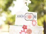 a bold wedding cake pinata guest book with prints, floral appliques is a unique idea to make your wedding bolder