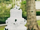 a  white and black fringe cake-shaped pinata wedding guest book is a gorgeous idea for a refined wedding and it will add a lot of fun