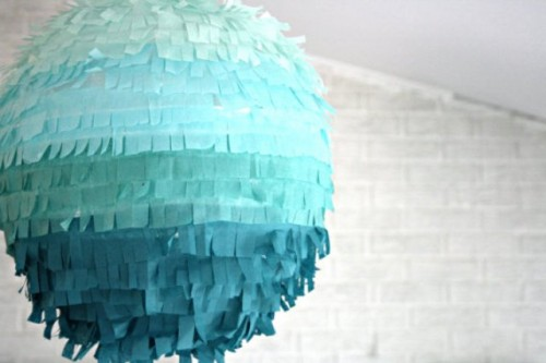 a turquoise ombre fringe pinata wedding guest book is a lovely and bold idea for a colorful modern wedding