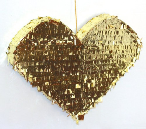 a glam gold fringe heart-shaped pinata wedding guest book is a very fun and creative idea for a glam wedding