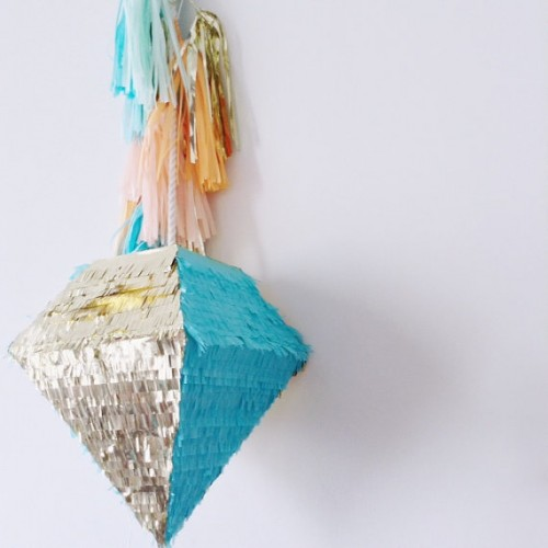 a beautiful and bold turquoise and silver fringe diamond-shaped pinata wedding guest book with colorful tassels is a veyr pretty and cool idea