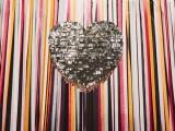 a classic glam silver fringe heart-shaped pinata wedding guest book is a very chic and cool idea for a modern glam wedding