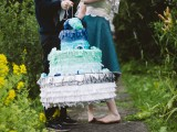 a creative and bold ombre fringe cake-shaped pinata wedding guest book from deep blue to silver is a very creative idea suitable for a big wedding