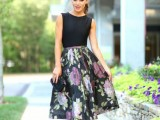 a stylish separate with a black sleeveless top, a moody A-line floral skirt, hot pink shoes and a black clutch