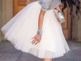 a cute look with a grey top with a cutout back, a tutu skirt, a metallic clutch and metallic shoes