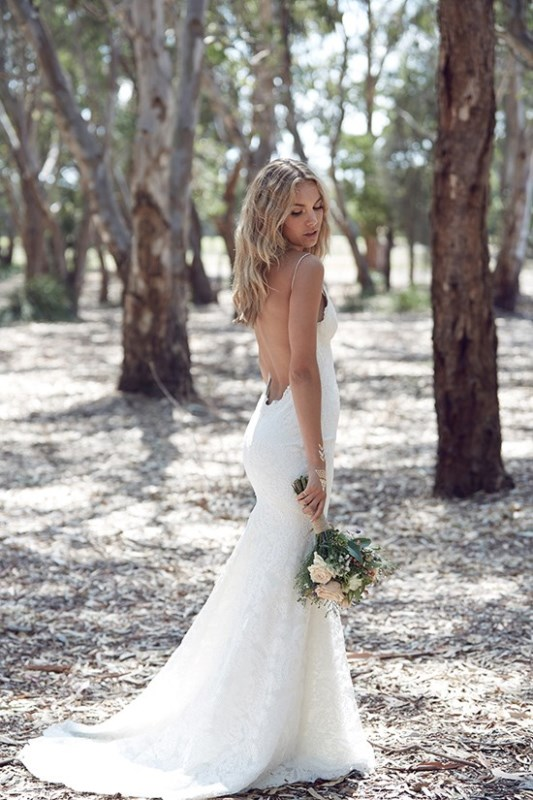 Picture Of wild love bohemian bridal shoot with stunning lace gowns  19