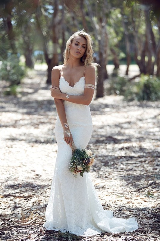 Picture Of wild love bohemian bridal shoot with stunning lace gowns  21