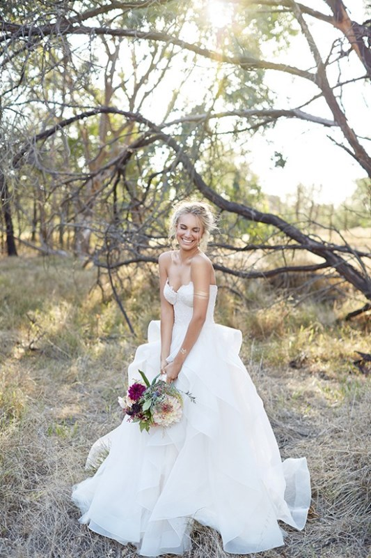 Picture Of wild love bohemian bridal shoot with stunning lace gowns  22
