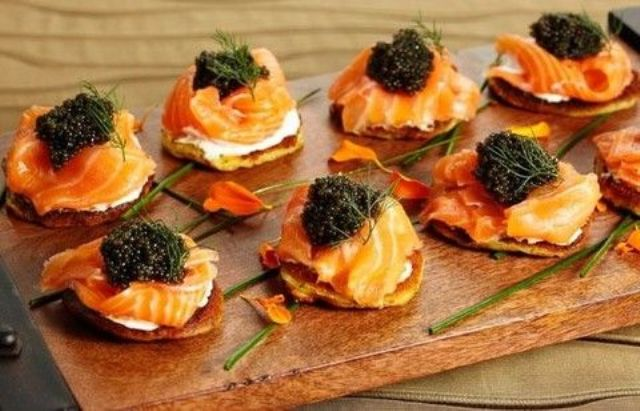 crackers with cream cheese, salmon, caviar and herbs is amazing for those who love seafood and Japanese cuisine