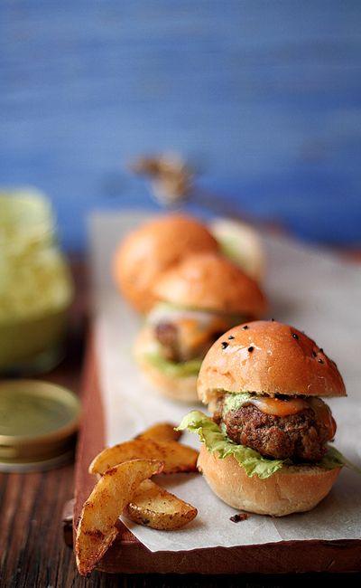 mini sliders with cheese and herbs are a timeless winter wedding appetizer that will please a lot of people