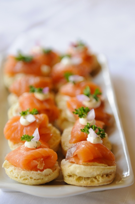 crackers with salmon and herbs and cream cheese are delicious winter wedding appetizers