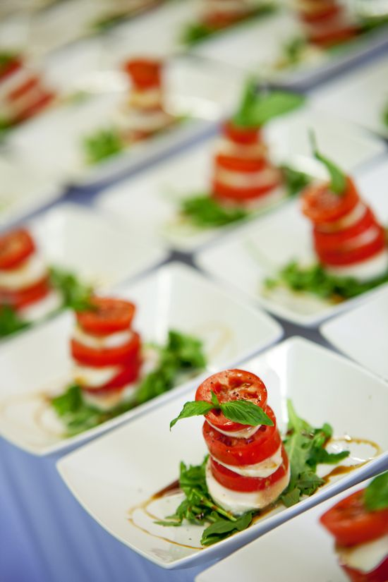mini Caprese appetizers of cheese, tomatoes and basil plus balsamic are delicious
