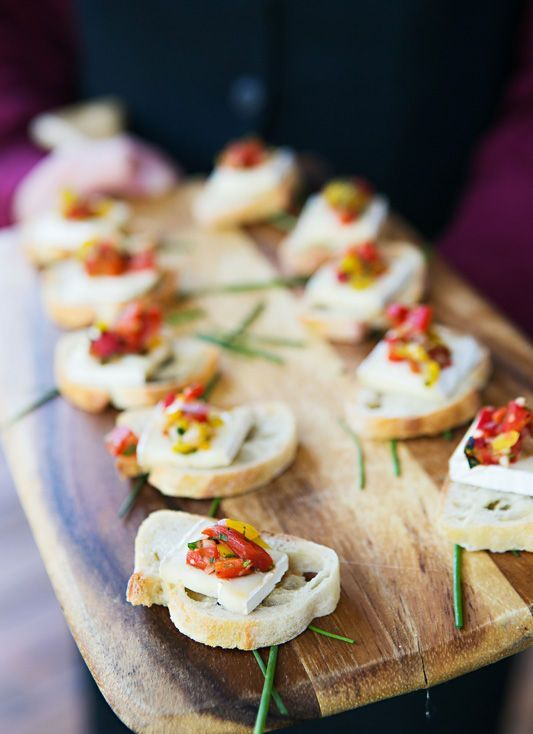 mini appetizers of toasts, cheese and sun dried tomatoes plus herbs will please both carnivores and vegetarians