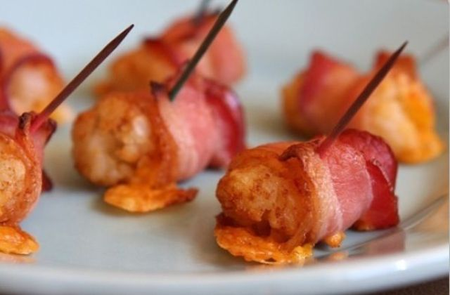 bacon slices wrapped and filled with cheese and eggs are a hearty and cool winter wedding appetizer