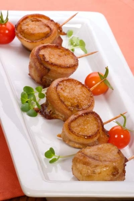 wrapped bacon slices filled with pate and placed on skewers is a very nutricious idea for a winter wedding