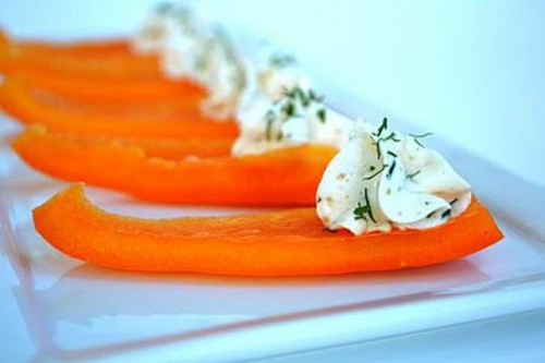 a vegan winter wedding appetizer of pepper slices and cream cheese with herbs will please carnivores too