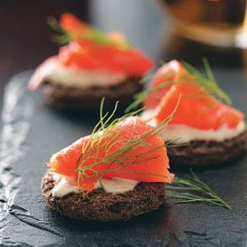toasts with cream cheese and salmon and herbs on top are an exquisite and delicious appetizer idea
