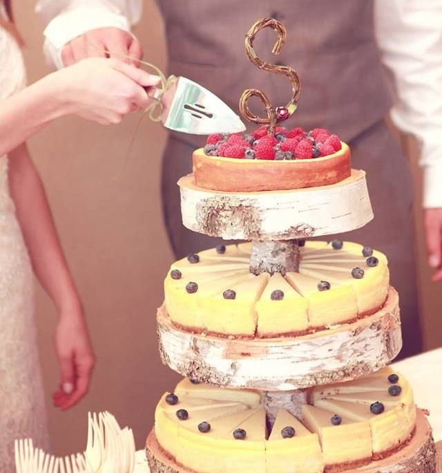 classic and berry cheesecakes topped with fresh berries are a fresh take on a traditional large wedding cake