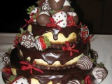 a wedding tiered cheesecake topped with dark chocolate drip and chocolate covered strawberries is a very whimsy option