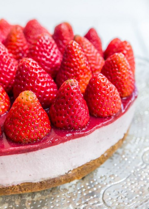 a strawberry wedding cheesecake with fresh berries is a delicious dessert for every wedding