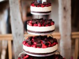 an assortment of classic cheesecakes with chocolate base, fresh berries and piece of brownies on top