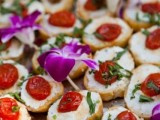 mini bruschettas with fresh herbs and tomatoes are amazing for spring or fall wedding appetizers