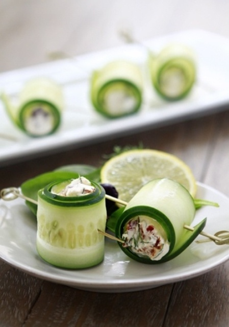 wrapped cucumber slices filled wiht herb and veggie salad inside and refreshed with lime