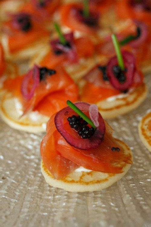 mini pancakes topped with salmon, leek and caviar are really delicious and amazing for any kind of wedding