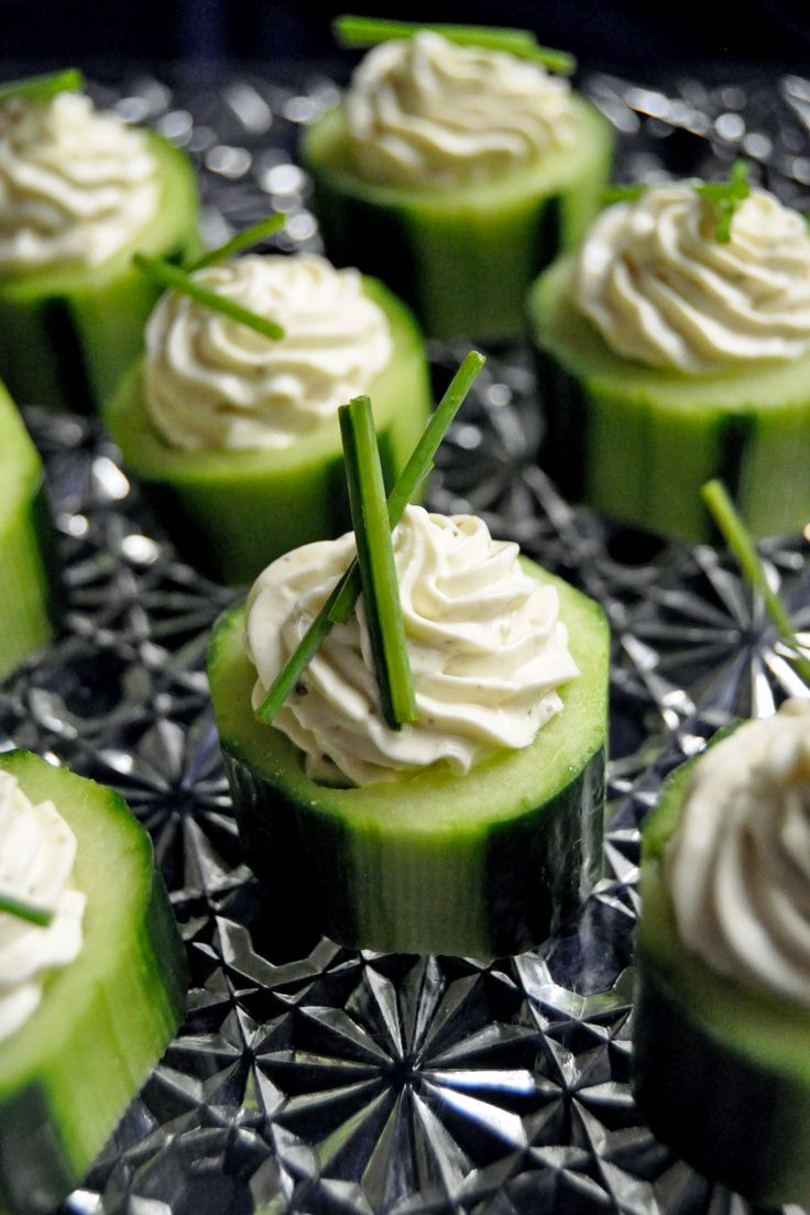 fresh cucumbers topped with dip and herbs are a simple and delicious idea for a spring wedding