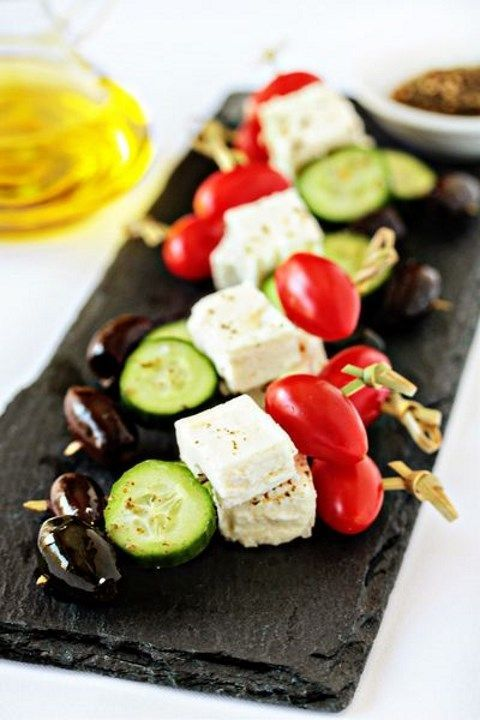 Caprese skewers with cucumbers and olives are a cool and very healthy idea for every kind of wedding