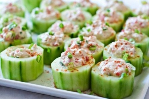 fresh cucumbers with crab meat in sauce and herbs is a tasty and delicious wedding appetizer