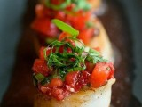 scallops with fresh tomato and herb salad on top is a very exquisite idea for any wedding including a spring one